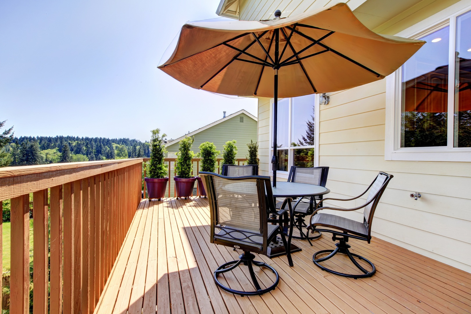 Deck with table, chairs and umbrella.